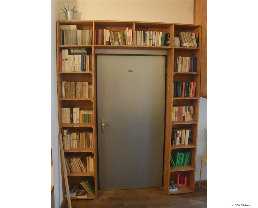 This neat bookshelf set-up frames a door in the back room...