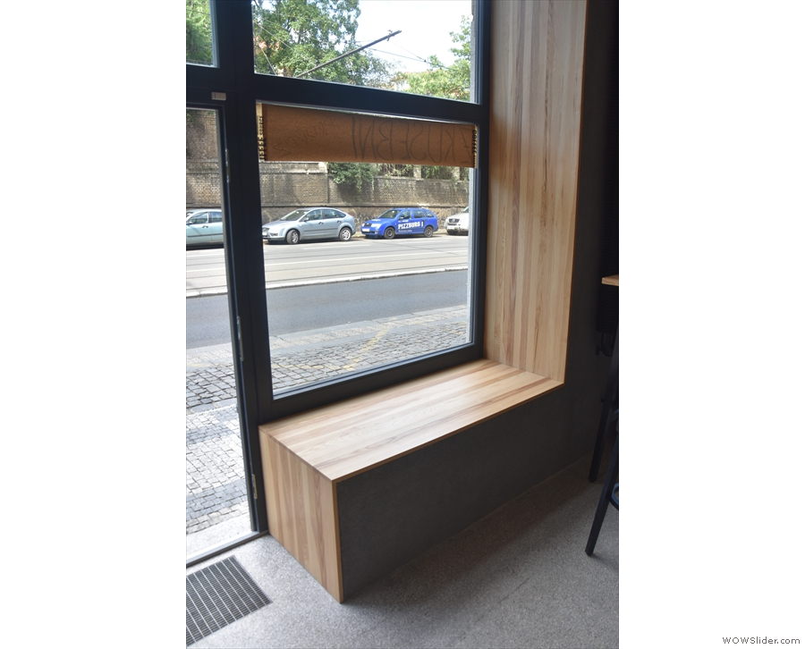 Immediately to the left of the left-hand door, the windowsill doubles as a bench.