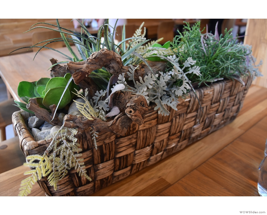 Most of them have little rectangular baskets of plants like these...