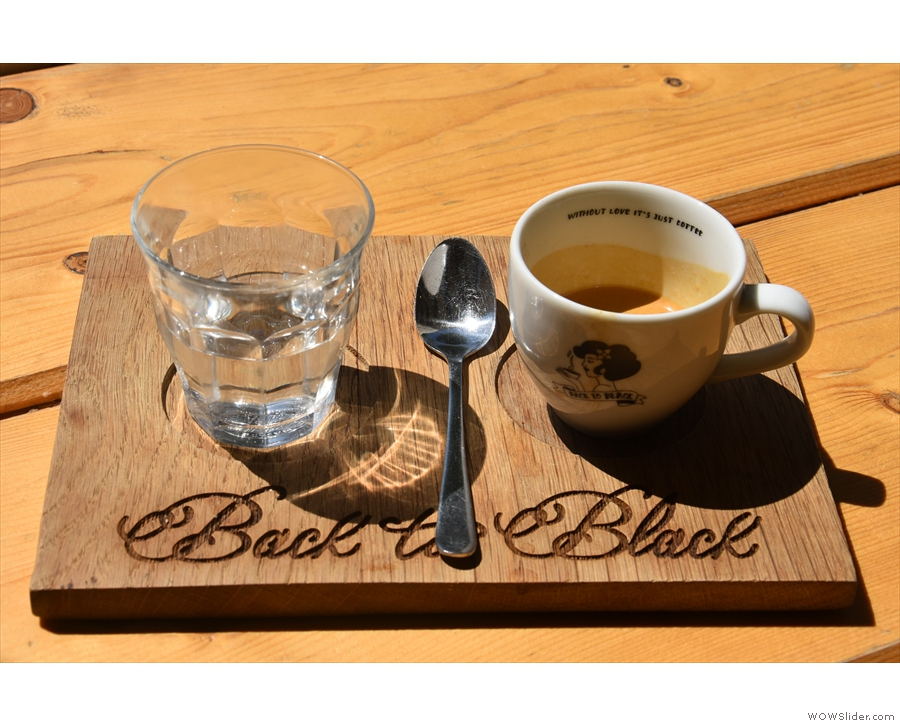 My espresso (the first of two) came served on a wooden tray, glass of water on the side.