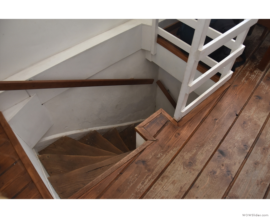 The stairs to the left of the door lead to a basement, but sadly it's only for storage.
