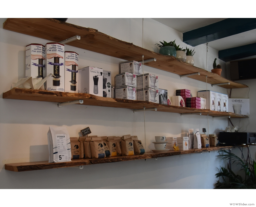 ... mix of coffee kit (middle shelf) and coffee beans (bottom shelf) for sale.
