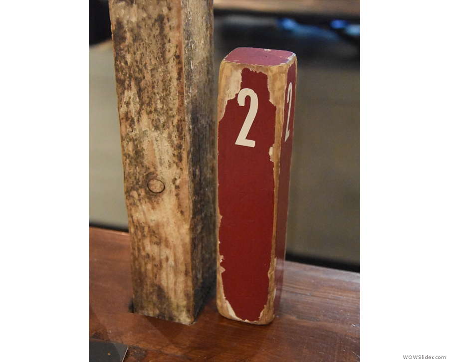 You order at the counter and get a numbered wooden peg to take to your table.