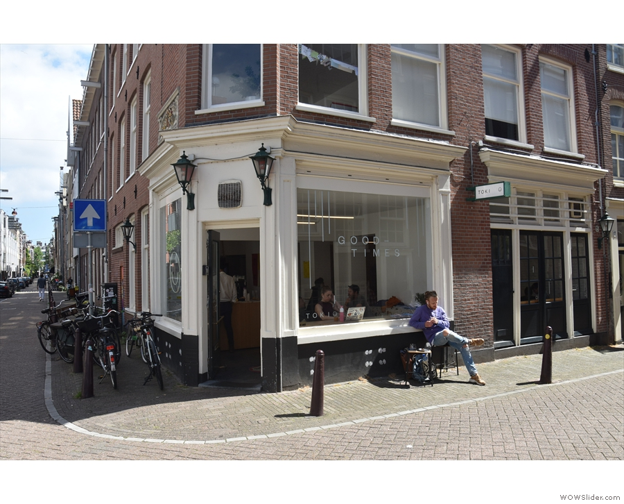 On a street corner in Amsterdam stands a bright, inviting space...