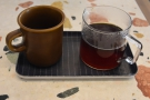 Here's my coffee, served in a carafe, cup on the side, all presented on a tray.