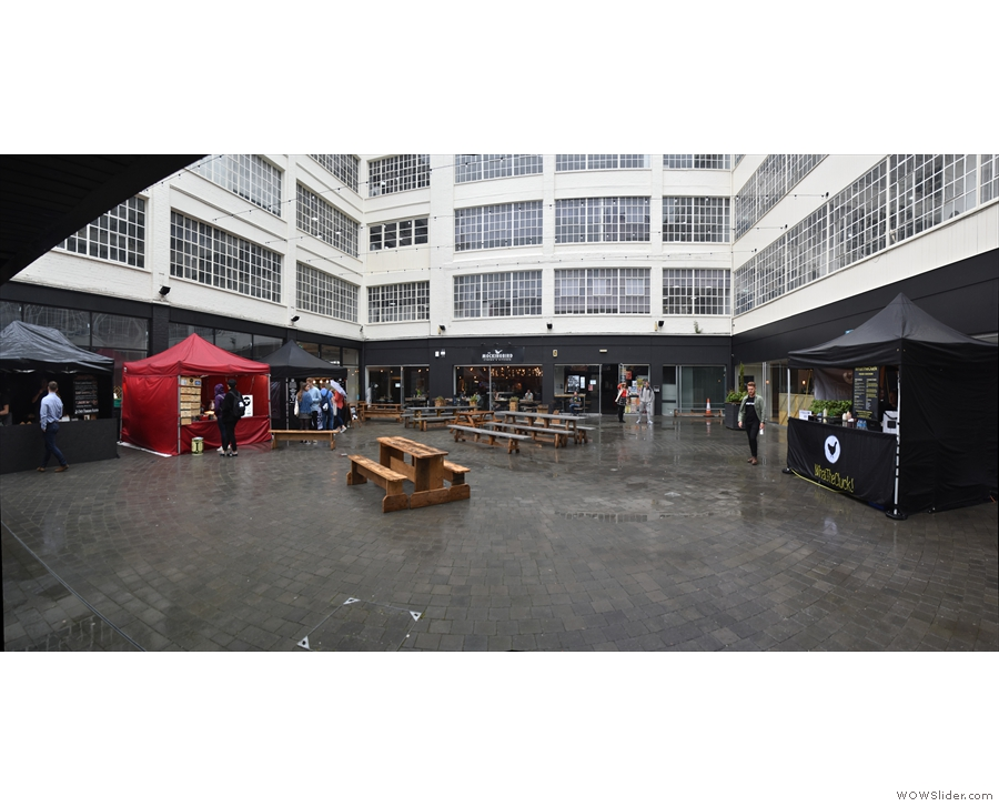 When I arrived on Friday, the Street Food Villlage was in a rainswept courtyard, its home...