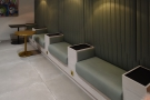 ... at the back where you'll find this long, padded bench-seat with in-built tables.