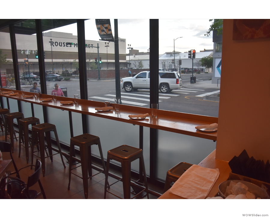 As well as the sets of four-person tables, there's a window-bar on the Girod Street side...