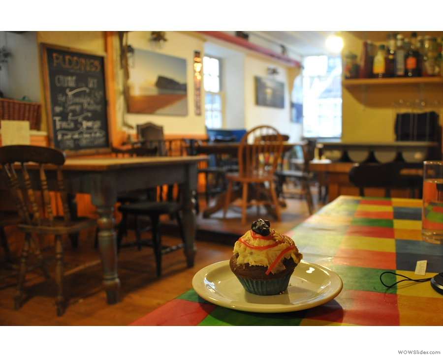 November: a cupcake surveys the room at Teignmouth's Oystercatchers Cafe