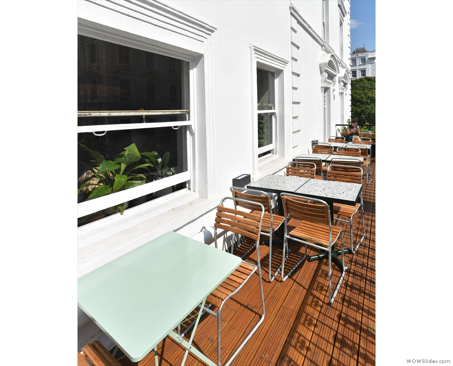 The terrace runs the The Pilgrm's full width, with four four-person tables to the right.