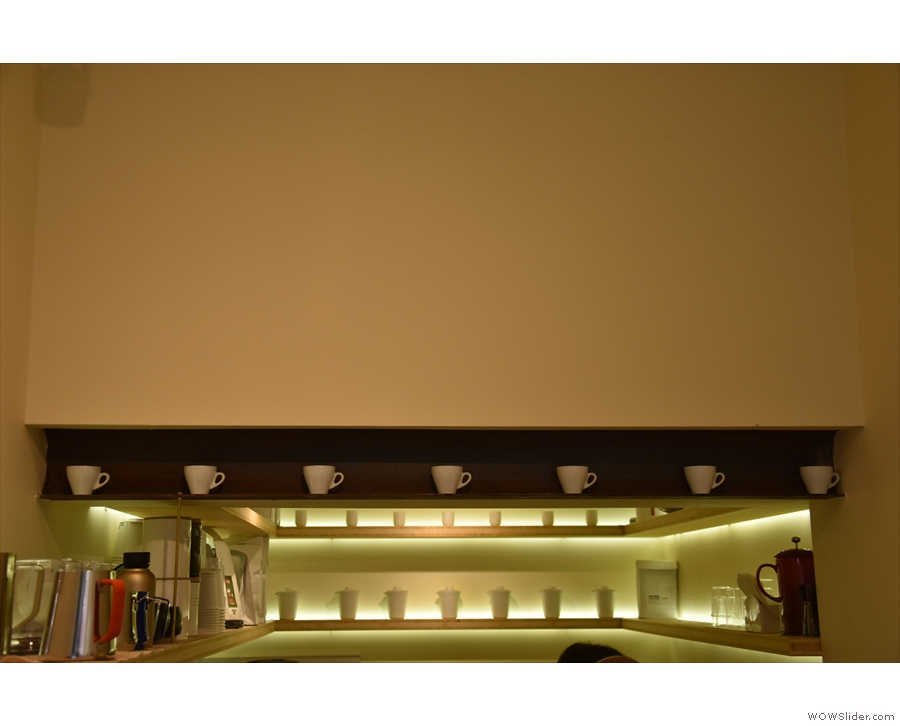 I loved the use of the girder above the counter as a shelf for the cups though!