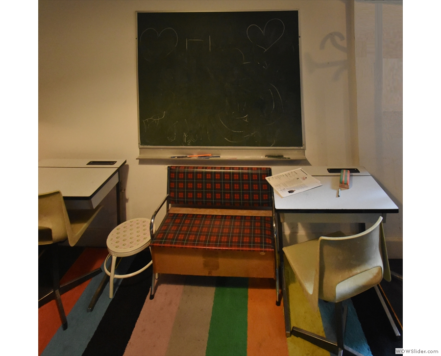 This time there's a pair of old school desks and a blackboard on the right...