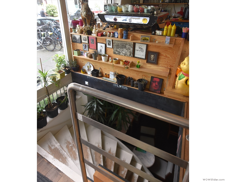 The counter, and the Kees van der Westen espresso machine also overlook the stairs...