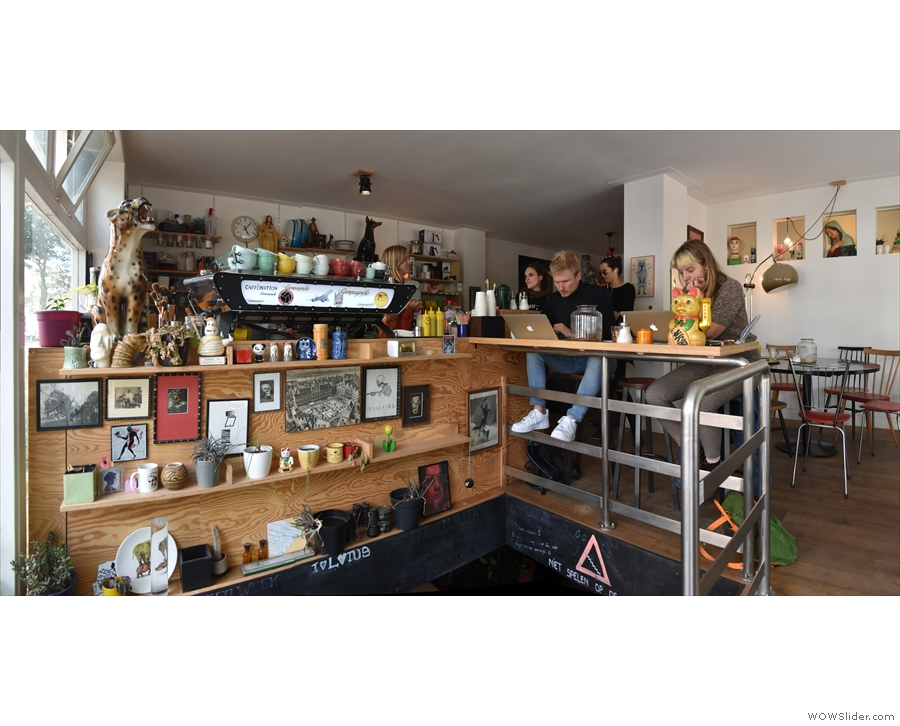 ... which, extending from the side of the counter, overlooks the stairs.