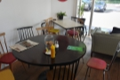 ... and next to this, against the back wall, a large, round table...