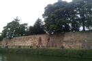 The massive southern curtain wall of Tonbridge Castle, seen from across the Medway.