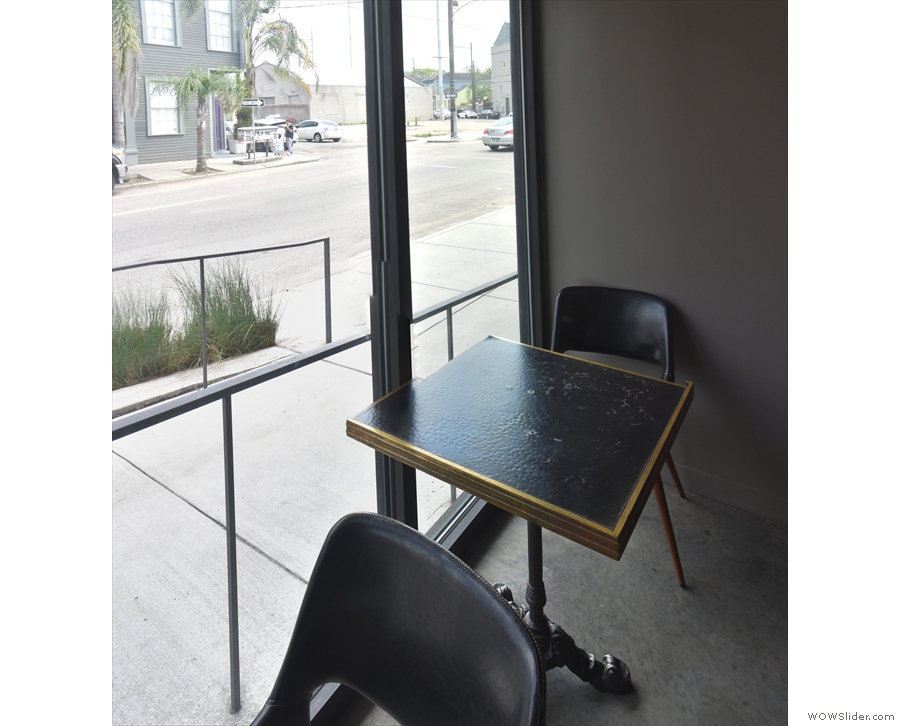... larger, square, one-person table (although you could turn the other chair around).
