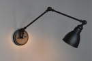 ... and this more conventional angle-poise lamp illuminates the back wall.