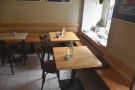 There are two two-person tables by the window immediately to the right of the door...