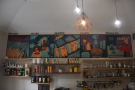 Above it all is a mural showing the stages of coffee production, from growing to serving.