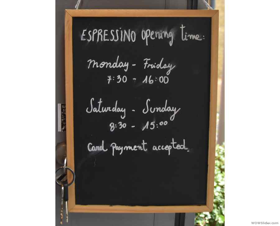The opening times are posted on the door.
