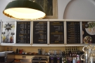The main menus, meanwhile, are on the wall behind/above the counter...