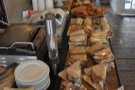 The counter was groaning under the weight of the sandwiches and cakes...