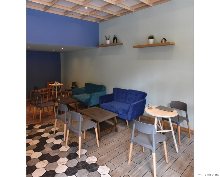 There's more seating against the right-hand wall, starting with a round, two-person table.