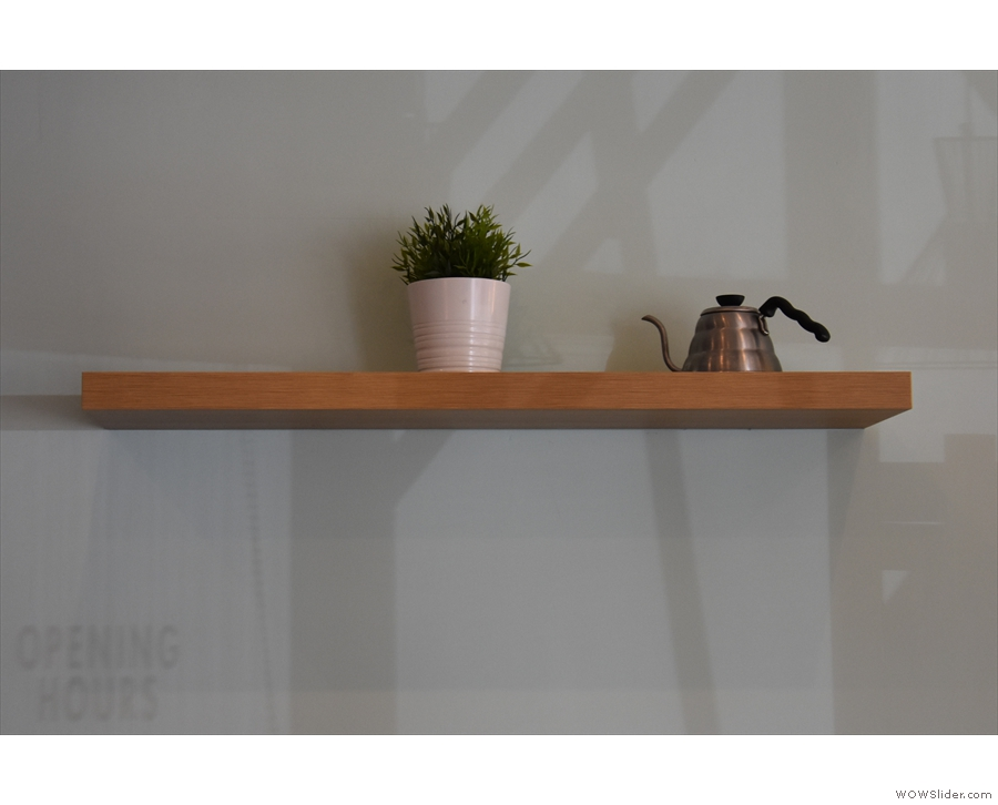 This shelf added some welcome decoration to the walls...