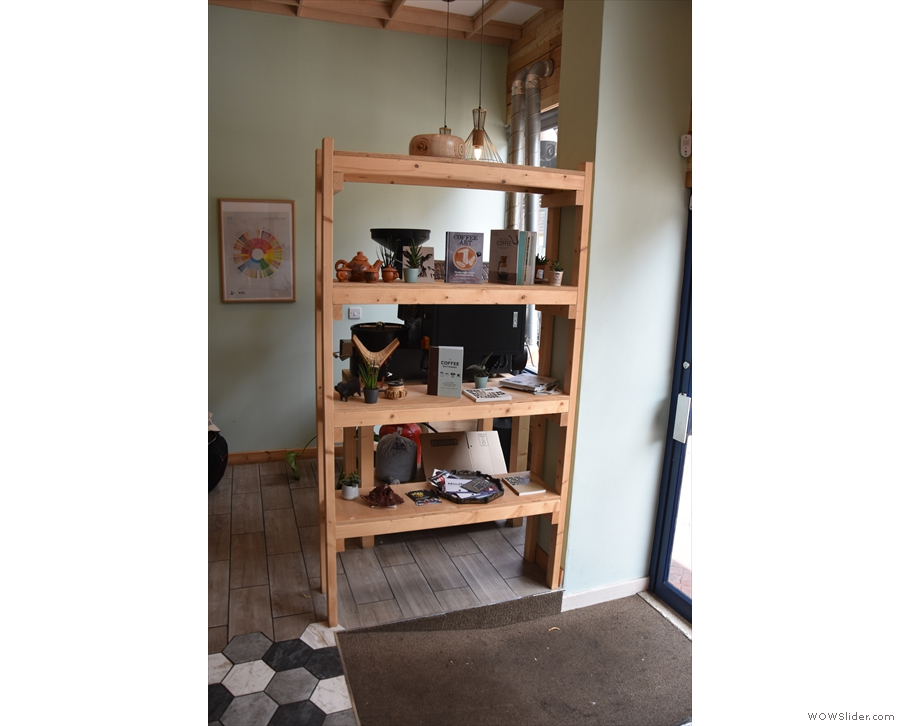 These bookshelves, immediately to the right of the door, shield off the roastery area.
