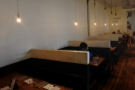 However, the main option is this row of six four-person booths along the back wall.