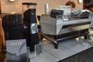 The espresso machine is a brand new La Marzocco KB90.