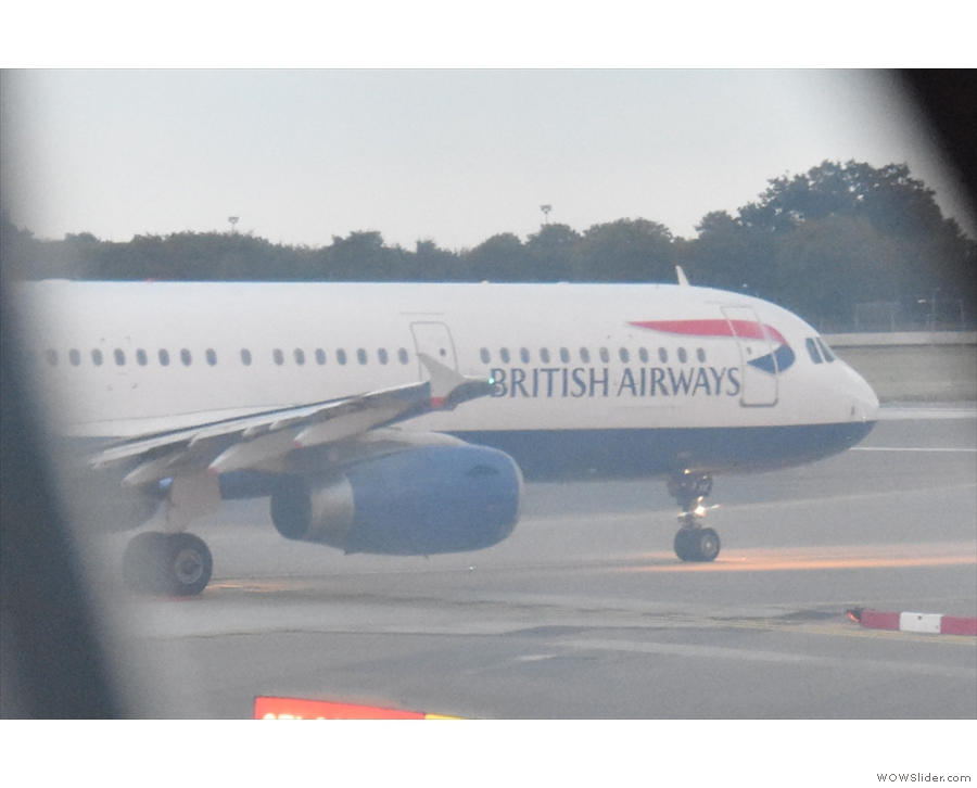 The final plane ahead of us, a British Airways one, swings onto the runway.