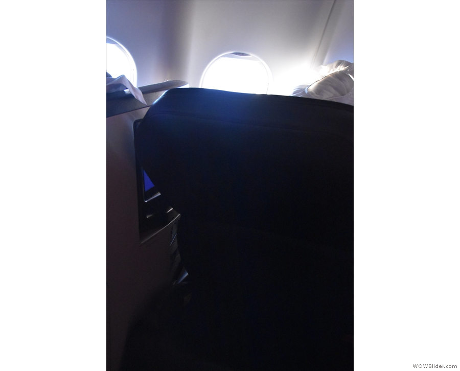 ... by having the back of the seat fold down towards you (sorry for the poor photo).