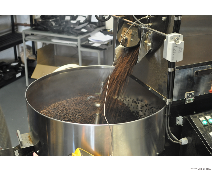 The sluice is opened and hot, just-roasted beans pour out into the cooling pan.