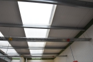 There's not much light from the front, but these two rows of translucent ceiling panels...