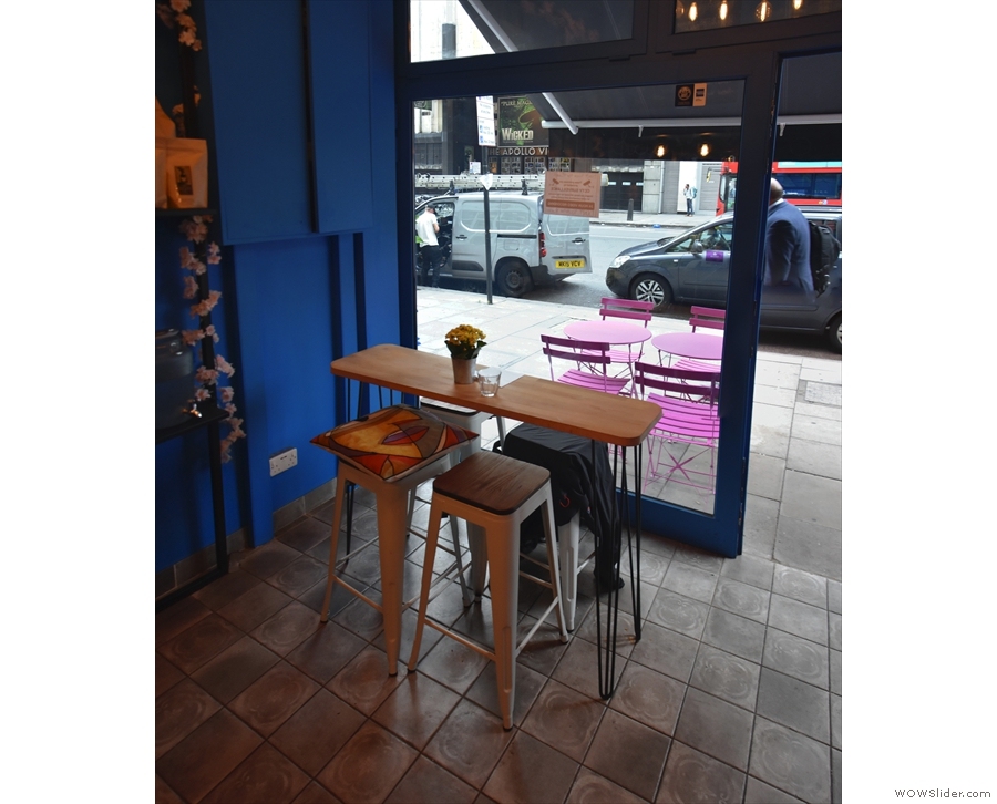 ... and this long, thin, four-person table in the window to the right of the door.