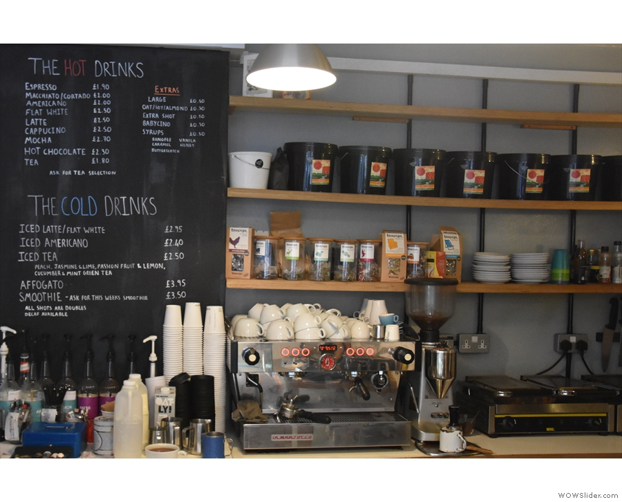 The coffee, meanwhile, is at the back of the counter, menu to the left.