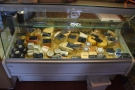 For more cheese, check out the display case on the right-hand side of the counter...