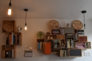 As well as pictures, there are several well-stocked bookshelves dotted around.