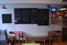 ... although there are also two small tables against the left-hand wall, under the menus.