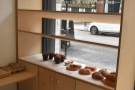To the right of the doors, the window sill and shelves above display the day's cakes.