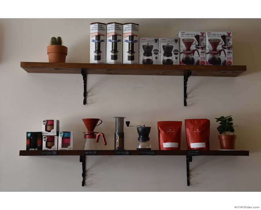 The retail shelves contain the usual mix of coffee equipment and retail bags of coffee.