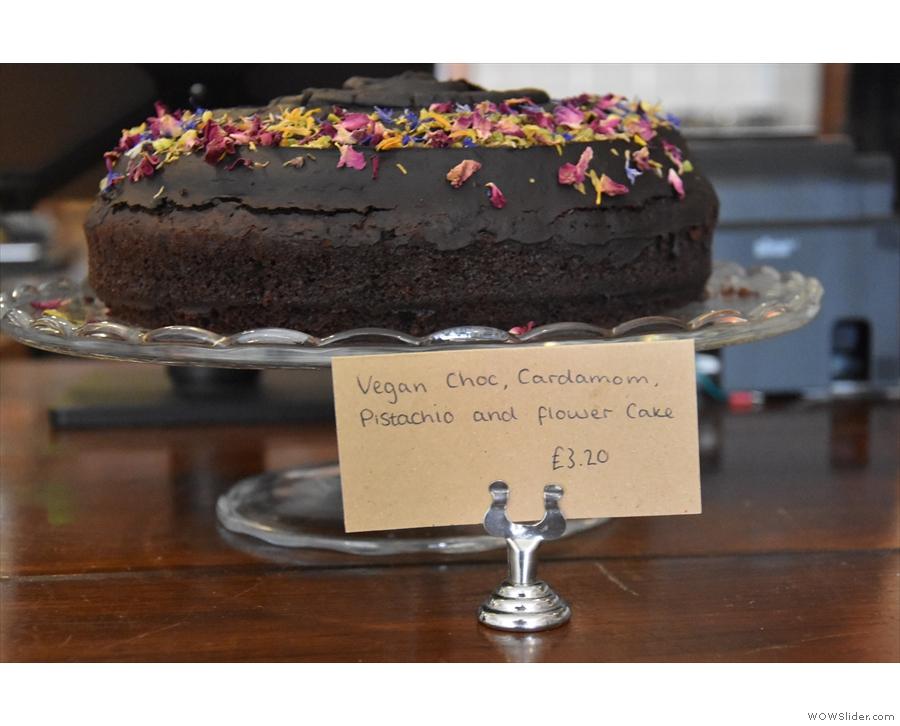 ... vegan chocolate, cardamom, pistachio and flower cake.
