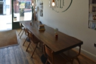 ... while on the opposite side, there's an eight-person communal table.