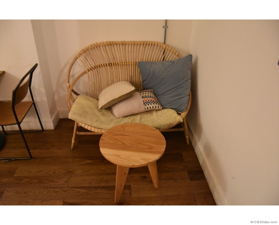 There's a wide one/two-person wicker chair tucked away to the right of the door.