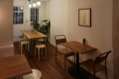 There's another small, two-person table on the right, this time with chairs.