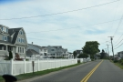 ... we reached a long stretch of road, with houses on either side, ocean to our left...