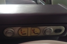 There are seat controls in the armrest on the other side, but I never worked them out!