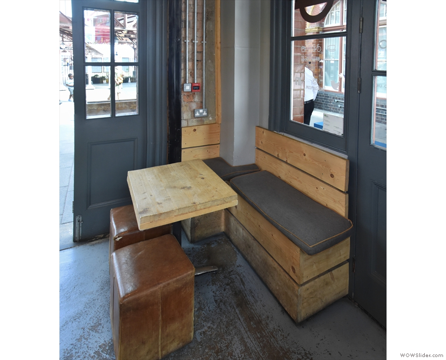 If you want to sit inside, this is the only seating, in the corner between the doors.